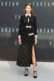 Alexa Chung sheathed her slim figure in an Alessandra Rich print dress, featuring a thigh-high slit, keyhole detail, and contrast cuffs and collar, for the European premiere of 'The Legend of Tarzan.'