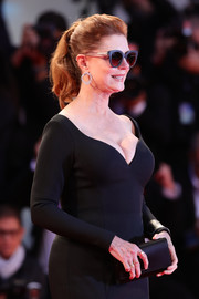 Susan Sarandon matched a black satin clutch with a low-cut gown, both by Hugo Boss, for the Venice Film Festival premiere of 'The Leisure Seeker.'