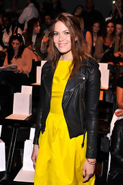 Mandy Moore juxtaposed a ladylike yellow frock with a bold leather motorcycle jacket.