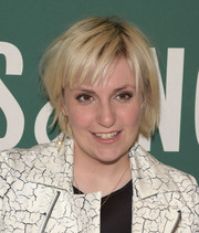 Lena Dunham rocked a messy short 'do with baby bangs during her book signing.