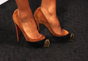 Ciara made a killer appearance in these brown and black suede pumps. They were embellished with gold studded at the toe.