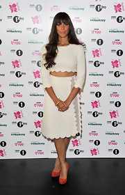 Leona was a scalloped beauty in a crisp white skirt and matching top in London.