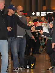 Leonardo is known for his classic, laid-back style. The actor greeted fans in jeans, a baseball cap and cross trainers.