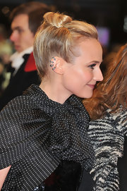 Diane Kruger wore her hair in an interesting updo featuring subtly rolled sides and a loosely pinned bun at the 62nd International Berlin Film Festival.