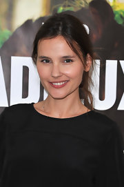 Virginie Ledoyen wore her hair swept back in a casual messy updo for the Parisian premiere of 'Les Adieux a la Reine.'