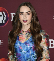 Lily Collins looked oh-so-sweet with her long center-parted waves at the 'Les Miserables' photocall.