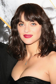 Marion showed off radiant waves while hitting the red carpet in Paris.