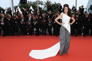 Andie MacDowell donned a white Toni Maticevski one-shoulder top with a long train for the 2019 Cannes Film Festival screening of 'Les Plus Belles Années d'une vie.'