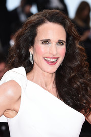 Andie MacDowell attended the 2019 Cannes Film Festival screening of 'Les Plus Belles Années d'une vie' wearing her signature long curls.