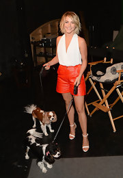 Julianne Hough's white halter top and orange leather shorts at the Purina Pets at Work campaign were a super stylish pairing.