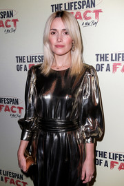 Rose Byrne matched a metallic tube clutch by Victoria Beckham with a gold dress for the opening night of 'The Lifespan of a Fact.'