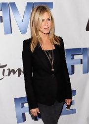 Jennifer Aniston showed off her sleek layered blond tresses at the 'Five' premiere.