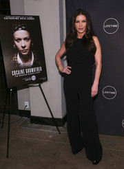 Catherine Zeta-Jones went for a minimalist black jumpsuit when she attended the Lifetime Luminaries screening of 'Cocaine Godmother.'