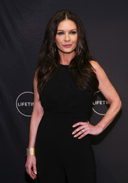 Catherine Zeta-Jones gave her black outfit a hint of shine with a gold lace-up cuff when she attended the Lifetime Luminaries screening of 'Cocaine Godmother.'