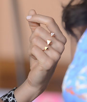 Stacy added a little bit of edge to her look by accessorizing it with this gold, studded knuckle ring.