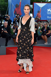 Alicia Vikander was rustic-chic in a Louis Vuitton tiered print dress with a sequined underlay at the Venice Film Festival premiere of 'The Light Between Oceans.'