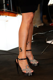 Simona Ventura stepped up the glam factor with her bejeweled platform sandals.