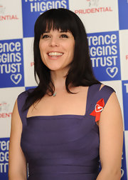 Neve Campbell wore a long straight cut with front bangs to the Lighthouse Gala Auction in London.