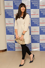 Claudia Winkleman attended the Lighthouse Gala auction wearing a  chic pair of shiny black leather pumps.