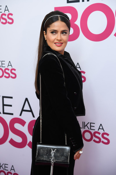 Salma Hayek accessorized with a chic Saint Laurent chain-strap bag at the world premiere of 'Like a Boss.'