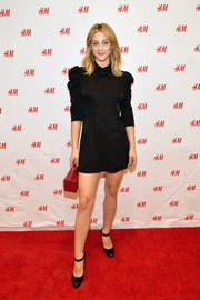 Lili Reinhart complemented her dress with a pair of black patent Mary Janes.