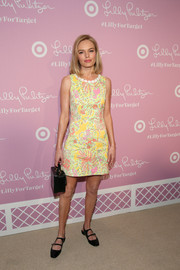 Kate Bosworth accessorized her outfit with a small black trunk by Mark Cross.