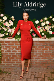 Adriana Lima matched her frock with red ankle-strap sandals.