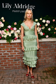 Karolina Kurkova teamed her frock with red polka-dot peep-toe mules by Chloe Gosselin.