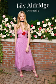 Martha Hunt completed her all-pink look with a pair of strappy sandals.