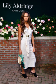 A straw purse with shell and tassel detailing finished off Joan Smalls' ensemble.