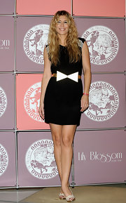 Raquel showed off her black day dress which she paired with a geometric belt.