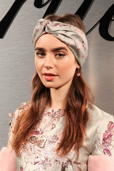 Lily Collins Headband [cartier celebrates the launch of santos de cartier watch,hair,clothing,hair accessory,hairstyle,headpiece,pink,beauty,fashion,headband,fashion accessory,arrivals,lily collins,red carpet,california,san francisco,pier 48,santos de cartier watch launch]