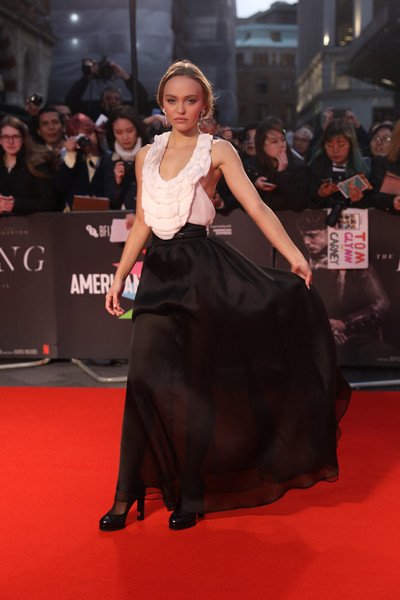 Lily-Rose Depp Halter Dress [the king,the king uk premiere,red carpet,carpet,premiere,clothing,flooring,dress,fashion,event,public event,neck,lily-rose depp,uk,odeon luxe leicester square,london,england,premiere,bfi london film festival]