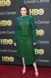 Lena Dunham brightened up the American Songbook Gala red carpet with her iridescent green dress, which featured a bateau neckline, velvet polka dots, and an asymmetrical hem.