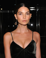 Lily Aldridge matched dangling gemstone earrings with a swept-back 'do for an elegant look during the Evening with Ralph Lauren event.
