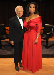 Oprah Winfrey donned a rich red off-the-shoulder evening dress for hosting An Evening With Ralph Lauren in NYC.