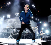 Chester Bennington went for a sporty look with a blue zip-up jacket and sneaks during a performance at the Staples Center.