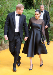 Meghan Markle complemented her dress with bejeweled slingback pumps by Aquazzura.