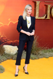 Laura Whitmore teamed a cropped navy pantsuit by Alexander McQueen with a Simba and Nala tee for the European premiere of 'The Lion King.'