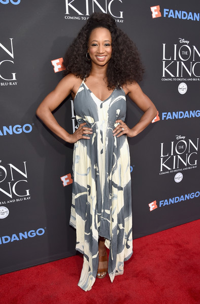Monique Coleman looked summery in a printed halter dress with a handkerchief hem at the 'Lion King' Sing-Along.