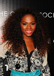 Tika Sumpter sported a voluminous curly 'do at the premiere of 'Safe.'