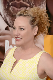 Virgina showed off her lovely blonde curls with this messy updo.