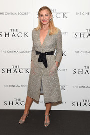 Faith Hill made a chic appearance at the world premiere of 'The Shack' wearing an embellished gray tuxedo dress by Monique Lhuillier.