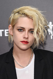 Kristen Stewart's red lipstick looked striking against her pale complexion.