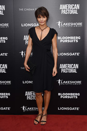 Helena Christensen showed off her ageless figure in a low-cut black wrap dress at the New York screening of 'American Pastoral.'