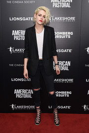Kristen Stewart balanced out a pair of distressed jeans with a crisp black blazer by Sandro for her red carpet look during the New York screening of 'American Pastoral.'