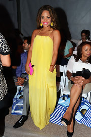 Christina popped in this bright canary silk gown at the Mercedes-Benz Swim Fashion Week in Miami.