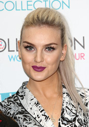 Perrie Edwards looked edgy-chic with her teased ponytail during the launch of her band's makeup range.