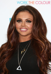 Jesy Nelson wore her lush locks in a cascade of waves during the launch of her band's makeup range.