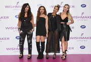 Jesy Nelson rocked a black graffiti-print jumpsuit during the launch of Little Mix's new fragrance.